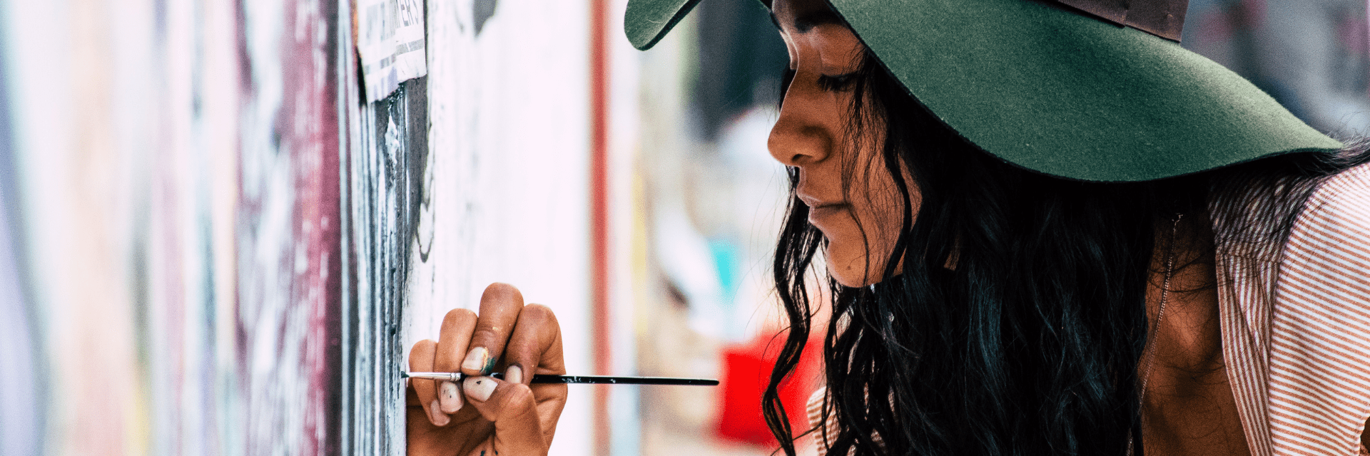 artist paints wall